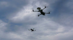 Several quadrocopter on a background of clouds Stock Footage