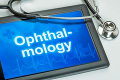 tablet with the medical specialty ophthalmology on the display - stock illustration