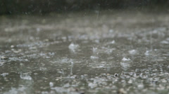 Raindrops splashes on the street Stock Footage