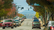 Stock Video Footage of View Down Asheville Citys Patton Avenue Towards Blue Ridge Mountains