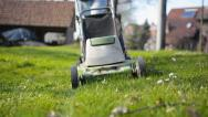 Stock Video Footage of Man mowing lawn (1)