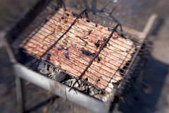 grilled pork steaks in the grid roasting in barbecue - stock photo