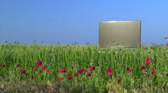Modern flat screen TV in the green field Stock Footage