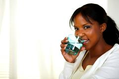 Pretty woman drinking healthy cool water - stock photo