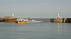 Windfarm Fast Support Vessels returning harbor, Lowestoft, Suffolk, England Stock Footage