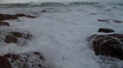 Rough seas, waves breaking on rocks and splashing camera, HD, UP24345 Stock Footage