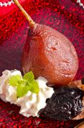 pear helene in red wine with spices - stock photo