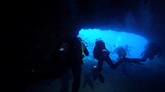 Chaotic hoard of scuba divers swimming in cavern in Australia, HD, UP24629 Stock Footage