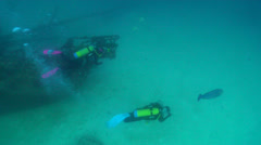 Group of scuba divers swimming on wreckage in Australia, HD, UP24711 Stock Footage