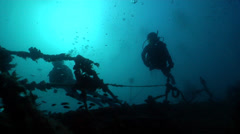 Buddy team of scuba divers swimming on wreckage in Australia, HD, UP24713 Stock Footage