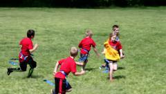 Flag football handoff and run. - stock footage
