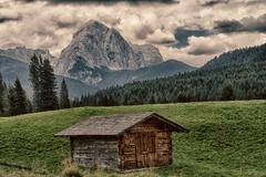 Characteristic mountains farmhouse called Baita, Dolomites - stock photo