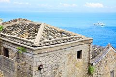 The Min-Eastern stone-laid style buildings by the sea Stock Photos