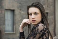 Profile of pretty brunette young woman outside Stock Photos