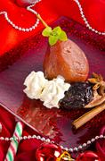 Pear helene in red wine with spices Stock Photos