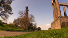 People are walking on the side of the Scottish National Monument Stock Footage