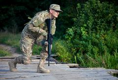 Soldier with a rifle Stock Photos