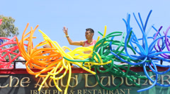 Colorful Ballons On Top of Bus Long Beach Pride Parade Stock Footage