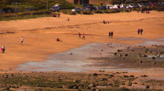 People walking on a big beach Stock Footage