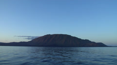 Stock Video Footage of Volcanic island shot from moving boat, HD, UP26171