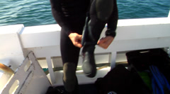 Diver straps on his dive knife, HD, UP26594 Stock Footage