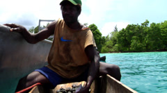 Stock Video Footage of Local fisherman gutting fish in his dugout canoe, underwater, HD, UP27452