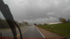 POV driving shot in heavy rain while storm chasing - stock footage