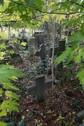 old tombstones in early autumn - stock photo
