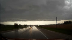 Stock Video Footage of POV driving shot in heavy rain while storm chasing