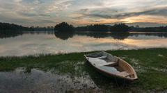 Timelapse of Single Boat During Sunset at Putrajaya Lake Stock Footage