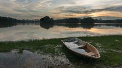 Timelapse of Single Boat During Sunset at Putrajaya Lake - stock footage