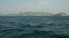 Traditional Long-tail boat tour. Coast of Krabi, Thailand. - stock footage