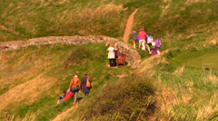 Hikers are walking on mountain trail - picnic - stock footage