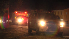 Night rescue vehicle arrives at attempted murder Stock Footage