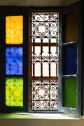 Open window with colored glass and arabic grill Stock Photos