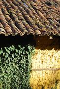 Adobe frame-build wall roof tiles  - stock photo