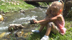 Child Playing with Teddy Bear Toy by a Mountain River, Tourist in Trip, Children Stock Footage