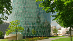 Round office building with trees in the foreground Stock Footage