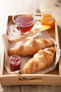 Fresh croissants with jam for breakfast Stock Photos