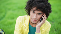Cute, handsome boy modeling appearance, talking on the phone Stock Footage