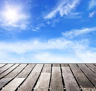 Blue sky and wood floor background Stock Photos