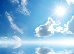 white fluffy clouds with rainbow in the blue sky - stock photo