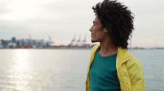 A man looks from ship to shore and smiling Stock Footage