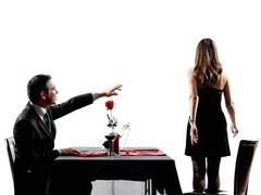 Couples lovers dating dinner  dispute separation silhouettes Stock Photos