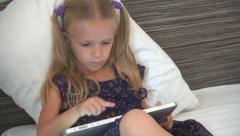 Child Playing, Surfing Wireless Tablet, Ipad, Device, Little Girl with PC in Bed Stock Footage