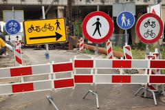 Contradicting traffic signs Stock Photos