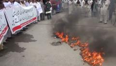 Protestors Burn Flags and Tires in Peshawar, Pakistan Stock Footage