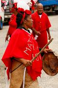 woman celebrate arriving fuifui moimoi on vavau island, tonga - stock photo