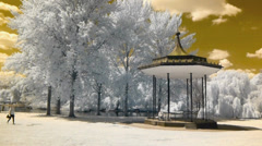 Park landscape with Victorian bandstand and lake Stock Footage