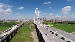 Aerial of Dallas Skyline Fly over iconic bridge toward downtown Stock Footage